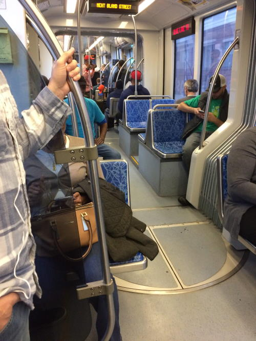 Photograph of riders on CATS LYNX light rail in Charlotte, NC